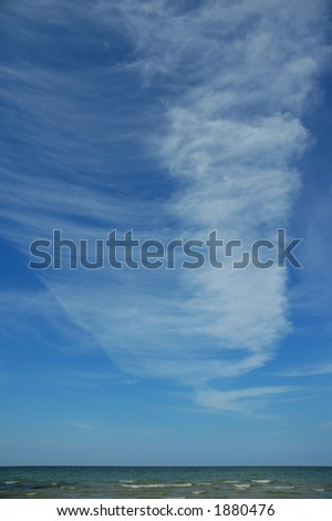 Fleecy clouds over the sea