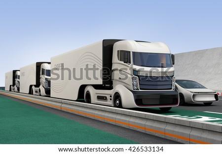Fleet of autonomous hybrid trucks driving on wireless charging lane. 3D rendering image. - stock photo