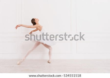 Flexible ballerina standing in semi position