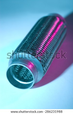 flexible connection for muffler in blue light - stock photo