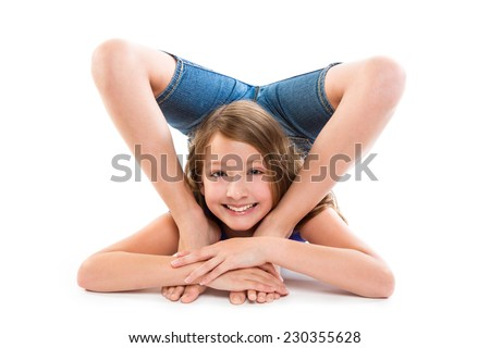 Flexible contortionist kid girl playing happy on white background - stock photo