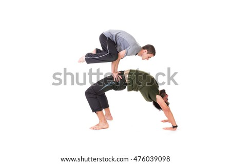 Flexible two man doing warmup equilibrium  exercise - isolated on white.