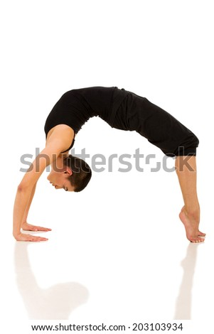 flexible woman doing yoga bridge pose on white background - stock photo