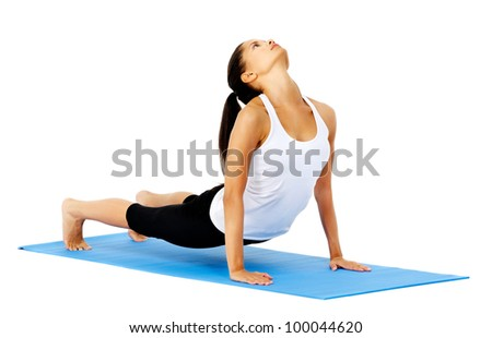 Flexible yoga woman does upward facing dog yoga pose. This is part of a series of various yoga poses by this model, isolated on white - stock photo