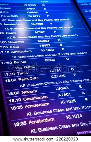 Flight arrival and departure sign board in airport - stock photo