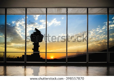 Flight control tower with twilight sky sunset and big window. - stock photo