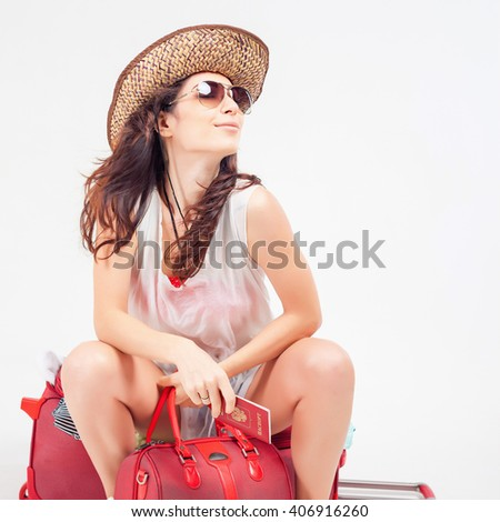 Flight delay. Happy woman with luggage waiting plane, airline at airport terminal. Suitcase. Traveler girl holding russian passport. Tourism. Tourist bag. Departure - stock photo