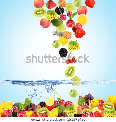 Flight fruits and berries in water on blue background - stock photo