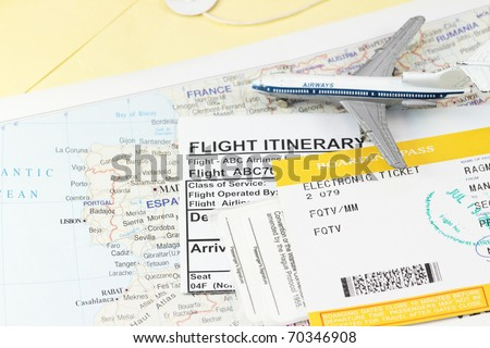 Flight itinerary with toy airplane and map abstract - stock photo