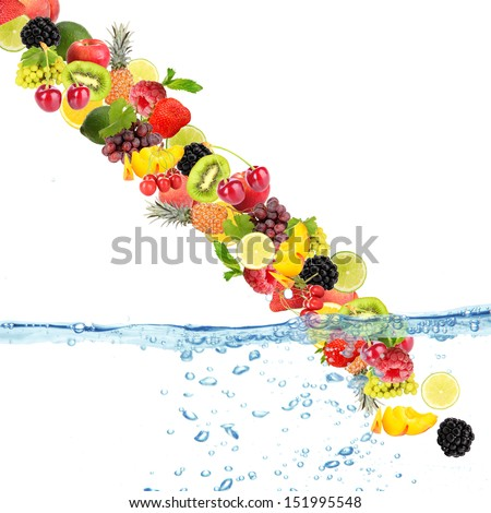 Flight of fruits and berries in water - stock photo