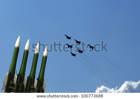 Flight of modern combat fighters on the sky background - stock photo