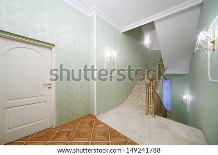 Flight of stairs, white marble stairs, green wallpaper in house in classical style. - stock photo