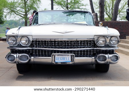 FLINT, MICHIGAN-JUNE, 2015:  Front end of a fully restored 1959 Cadillac Coupe de Ville convertible. - stock photo