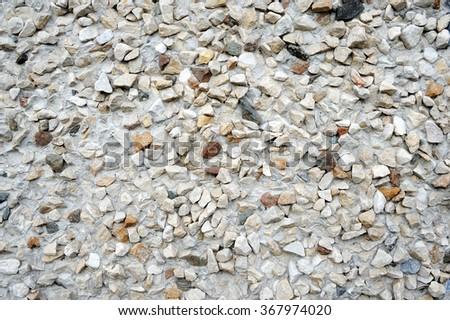 Flintstone in a frozen cement mortar, pattern, background, textu - stock photo