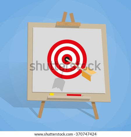 Flip chart with target, and arrow - stock photo