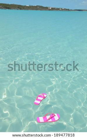 Flip-flop on the beach - stock photo