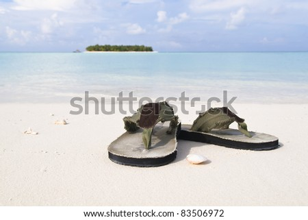 Flip-flop on white sand beach of a paradise island in Maldives - stock photo