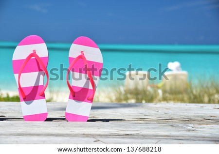 Flip-flops against ocean. Exuma, Bahamas - stock photo
