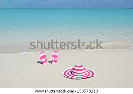 Flip-flops and hat on the beach  - stock photo