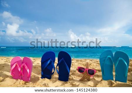 Flip flops and starfish with sunglasses on sandy beach in Hawaii, Kauai - stock photo