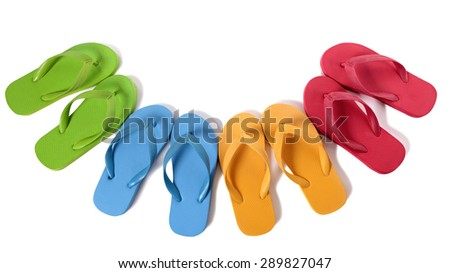Flip flops in a semi circle isolated on white background.