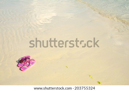 Flip flops on a tropical beach - stock photo