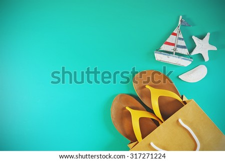 Flip flops on mint green background with copy-space. Summer colors style. - stock photo