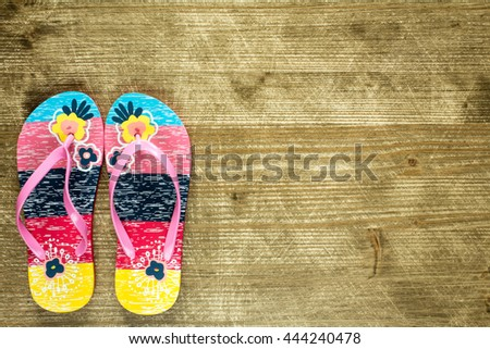 Flip flops on old wooden floor. Top view and copy space. - stock photo