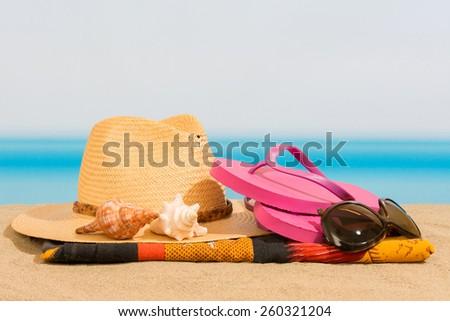 Flip flops on the beach - stock photo