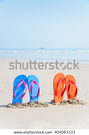 Flip-flops on the beach, on tropical sand. Summer vacation concept.