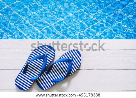 flip-flops on the swimming pool