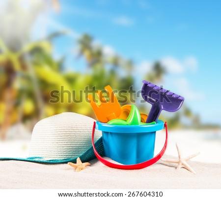 flip-flops, sand cake children  with tropical beach background, summer accessories - stock photo