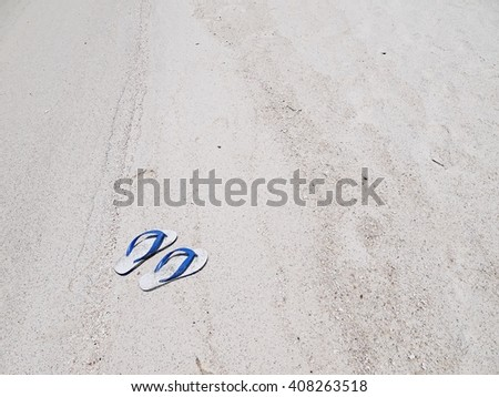 Flip flops(Sandal) on a sandy ocean beach with copy space. - stock photo