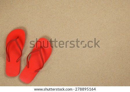 Flip Flops sandals in sand summer vacation holiday with copyspace - stock photo