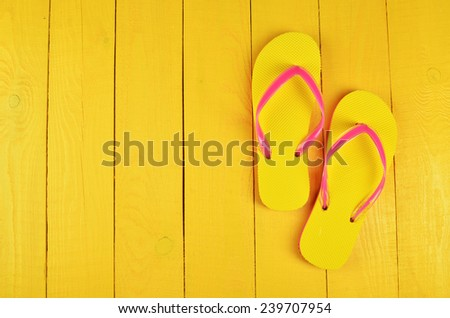 Flip Flops Yellow on yellow wooden background - stock photo