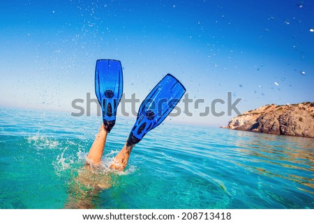 Flippers in water. Diver fins. Active vacation at sea.