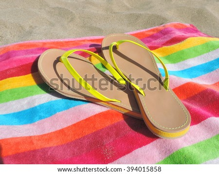 Flips Flops on a striped beach towel. Beach scene