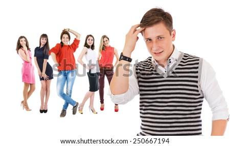 Flirting boy portrait with group girls - stock photo