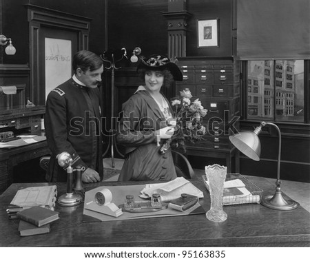 Flirting couple with bouquet of flowers