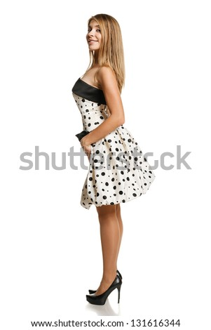 Flirty young girl in romantic dress in full length, over white background