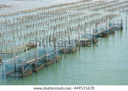 floating basket for keeping live fish in the sea at thailand - stock photo