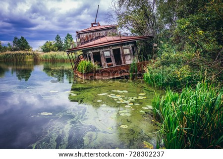 Floating boat on a Yanov backwater in abandoned Pripyat city, Chernobyl Exclusion Zone, Ukraine