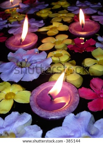 Floating Candle and Flower - stock photo