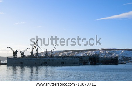 Floating dock in port of Murmansk. North of Russia. - stock photo