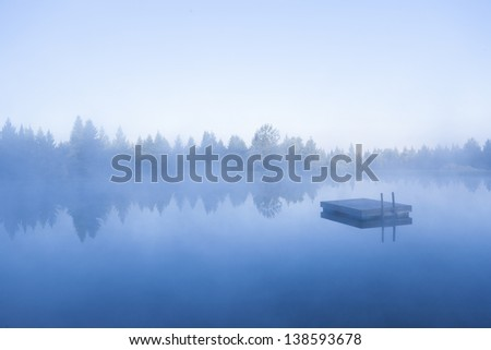 Floating dock on a blue foggy morning, Stowe Vermont, USA - stock photo
