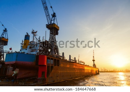 floating dock with a container ship in the harbour