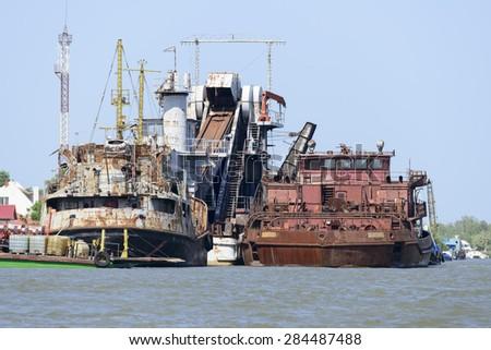 floating dredge - stock photo