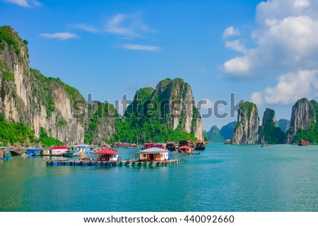 Floating fishing village in Halong Bay, Vietnam, Southeast Asia. UNESCO World Heritage Site. - stock photo