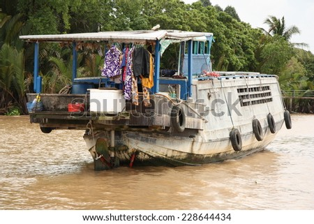 Floating house in Mekong Delta, Vietnam - stock photo