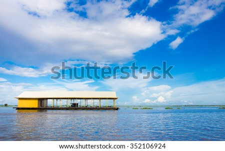 Floating House on the sea - stock photo